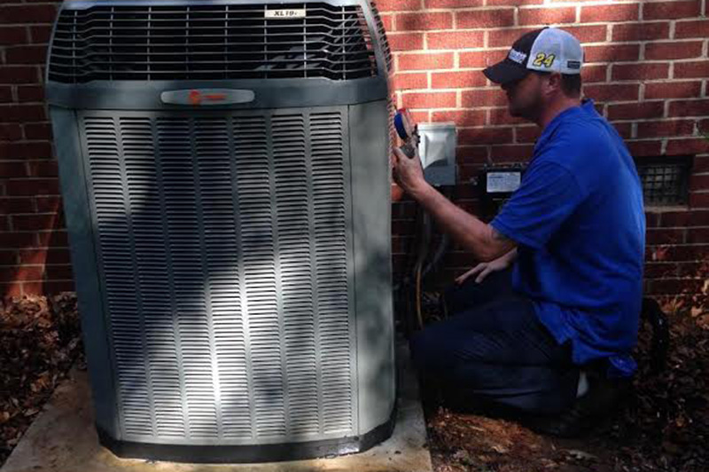 Man cleaning the AC